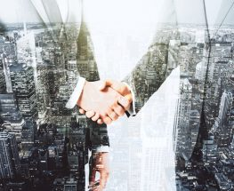 Double explosure with businessmen shaking hands and night city view