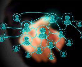 Businessman drawing social network on virtual screen